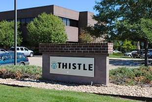 Thistle sign and office