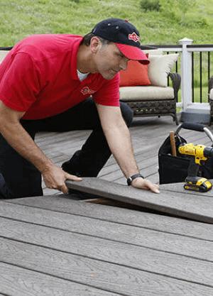 Technician working on an outdoor deck