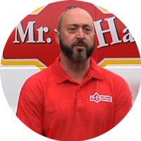 Rob standing in front of a Mr. Handyman van