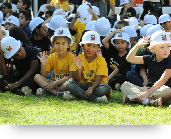 Smiling students outside wearing hardhats