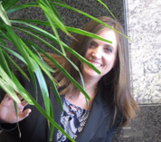 Keri H funny photo (she is hiding behind a plant)