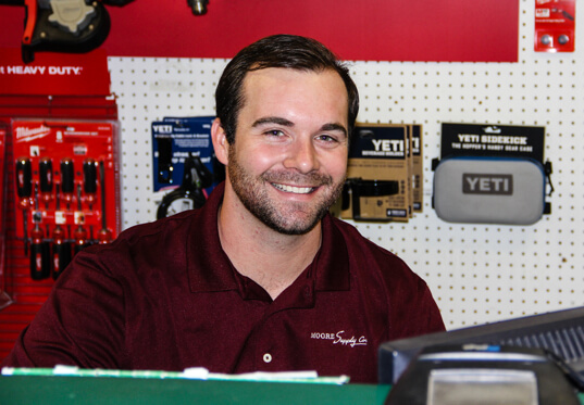 Moore Supply Co employee smiling in a store